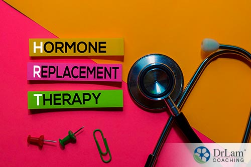 An image of the words hormone replacement therapy with a stethoscope and paperclip by them