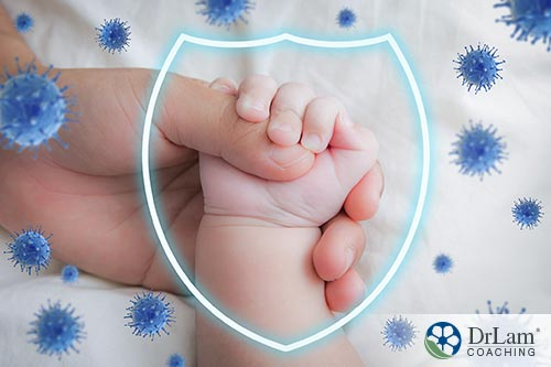 An image of a mother holding her baby's hand