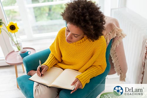 An image of a woman journaling