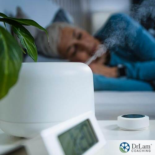 An image of an older woman sleeping with her humidifier going next to her bed