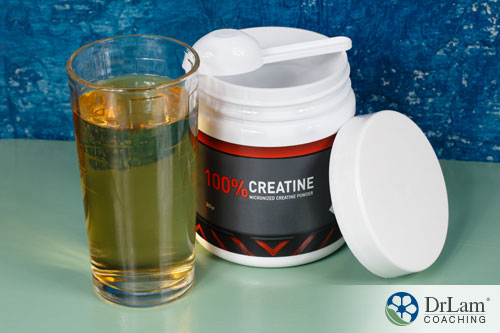 An image of a creatine supplement in a jar and a glass