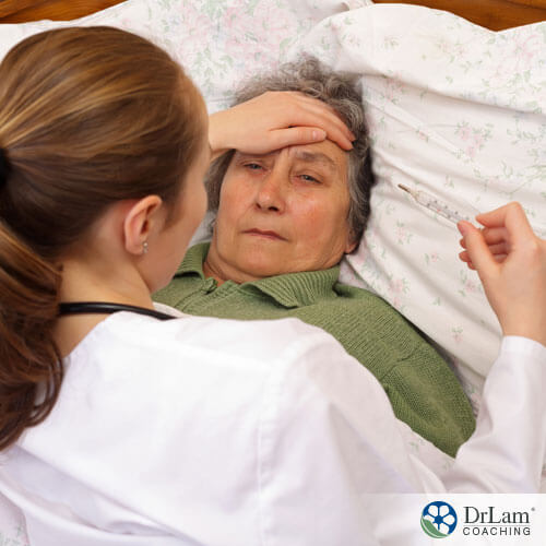 An image of a sick older woman in bed fighting an infection