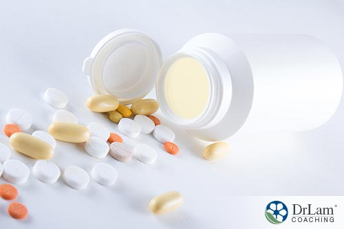 An image of Antiparasitic pills spilling out onto a while tabletop