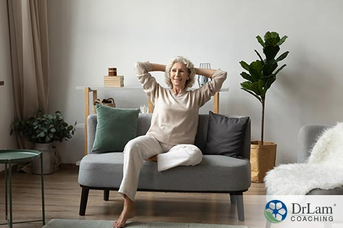 An image of a woman relaxing on her couch