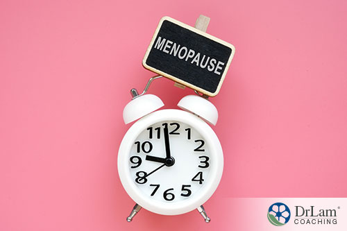 an illustration of the word menopause showing time is running out with a pink background