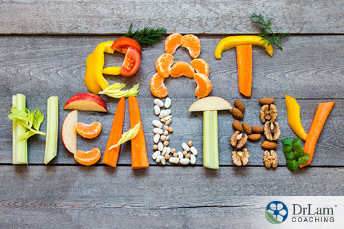 a presentation of healthy foods carved and formed into a word eat healthy