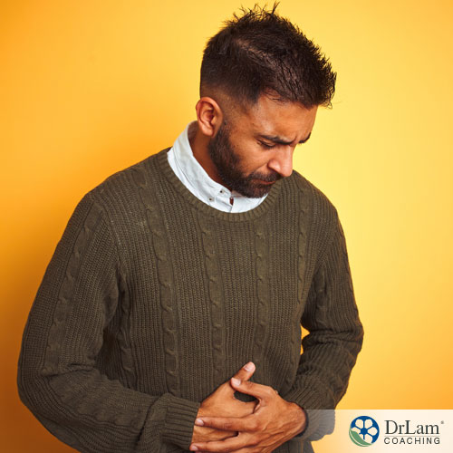 An image of a man suffering from low stomach acid symptoms