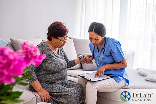 An image of an older woman getting her vitals checked by a young female nurse