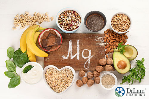 An image of various food high in magnesium arranged around a wood sign