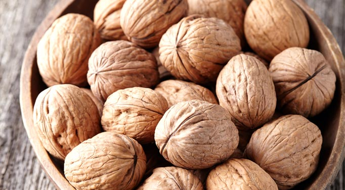 Find the Benefits of walnuts by eating a healthy bowl of raw walnuts.
