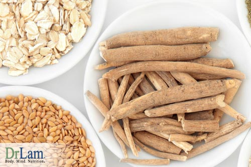 Dried and cut ashwagandha in a bowl next to a bowl of meat and nuts, indicating the benefits of ashwagandha are complementary to a healthy life