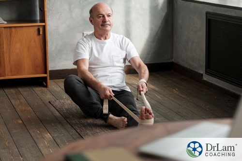 An image of an older man practicing gentle yoga
