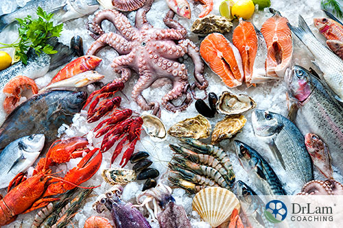 An image of a variety of seafood on ice