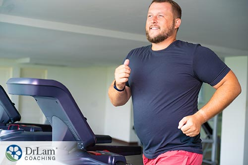 An image of a man running on a tredmill