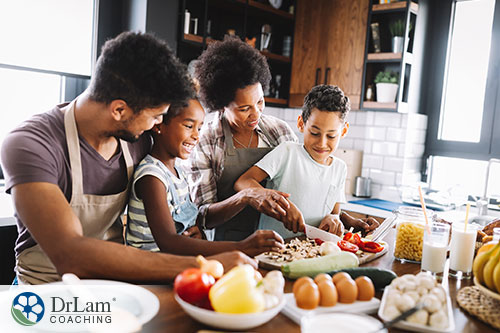 An image of a family cooking healthy food together