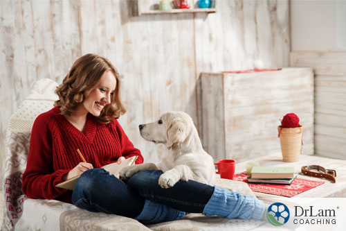 An image of a woman enjoying pet therapy