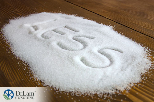 Image of a pile of sugar with the word less written in it