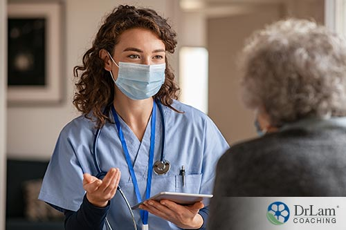 An image of an older woman talking to her doctor