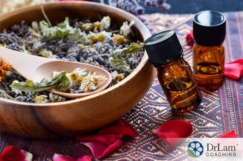 An image of dried lavender and chamomile along with essential oils which are good sleep problem solutions