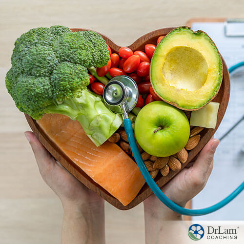 An image of healthy foods in a heart-shaped bowel with a stethoscope on top