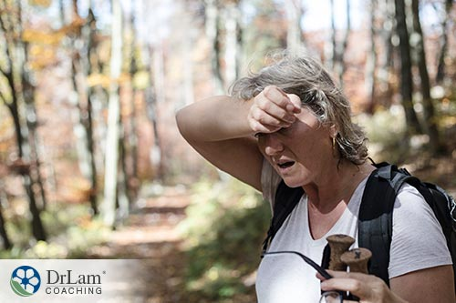 An image of a fatigued woman trying to hike