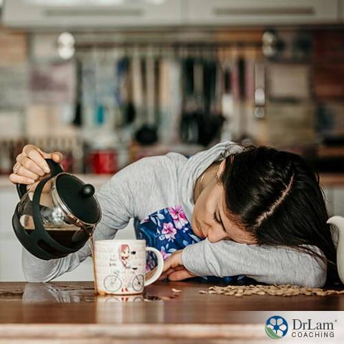 An image of a fatigued woman pouring coffee onto the table instead of in her cup