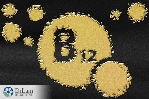 An image of gold powder on a black background with B12 written in it
