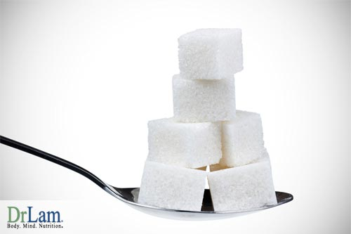 A spoonful of sugar cubes which may harm the body compared to natural healthy sweeteners