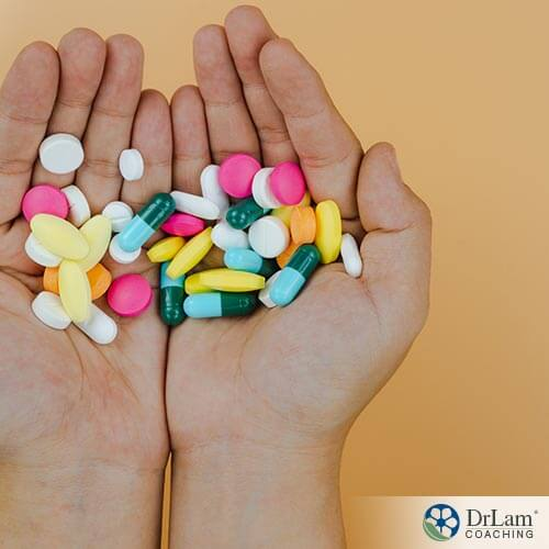 An image of human hands holding supplements