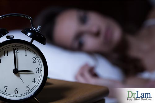 Woman lying in bed wide awake while clock reads 3:00 needs help falling asleep