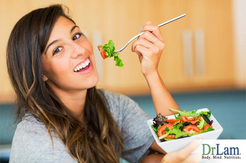 A young woman eating a salad, which big food companies likely contributed to