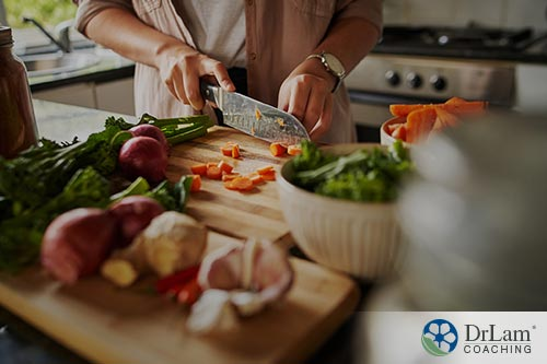 An image of a woman chopping vegetables on a cutting board