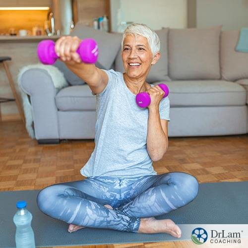 An image of a woman exercising with dumbbells
