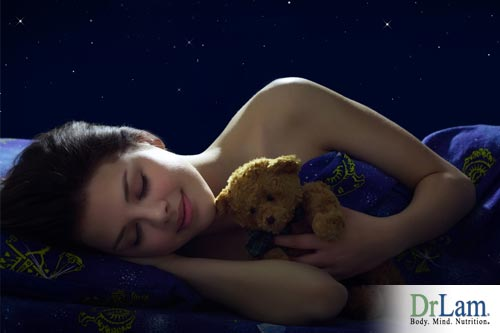 Woman asleep at night keeping healthy biorhythm which is why sleep is important