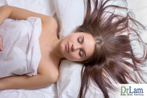 Woman sleeping, benefiting from why sleep is important