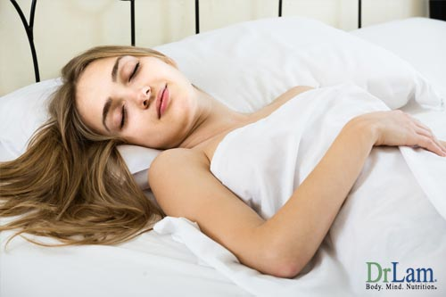 Woman asleep in bed resting, which is key to why sleep is important